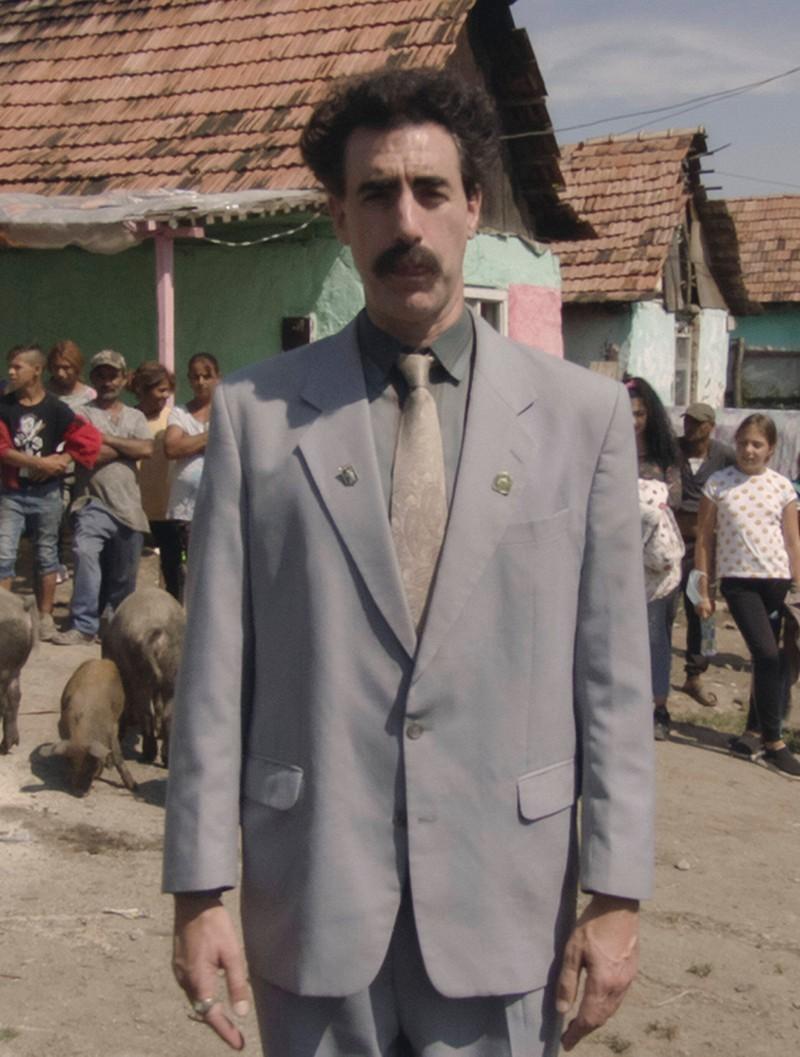 Borat mit Bart und typischer Frisur.